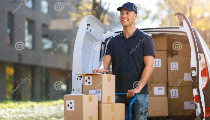 smiling-delivery-man-standing-front-his-van-smiling-delivery-man-loading-boxes-his-truck-133039169